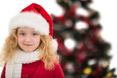 Festive little girl in santa hat and scarf. On white background Stock Photos