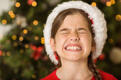 Festive little girl scrunching up her face Royalty Free Stock Photography