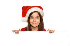 Festive little girl showing card Royalty Free Stock Photos