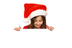 Festive little girl showing card Stock Photo