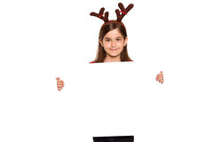 Festive little girl showing card Stock Photo