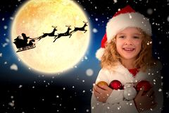 Composite image of festive little girl smiling at camera royalty free stock photos