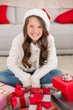Festive little girl smiling at camera with gifts Stock Image