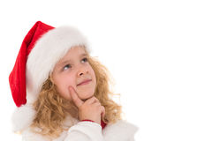 Festive little girl thinking and looking up Royalty Free Stock Photo