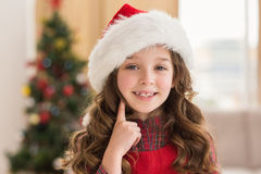 Festive little girl thinking and smiling Royalty Free Stock Photography