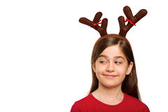 Festive little girl wearing antlers Stock Image
