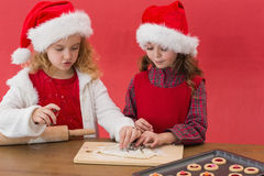 Festive little girls making christmas cookies Royalty Free Stock Photos