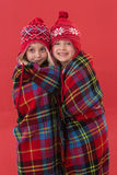 Festive little girls under a blanket Royalty Free Stock Image