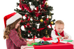 Festive little siblings drawing pictures Stock Photos
