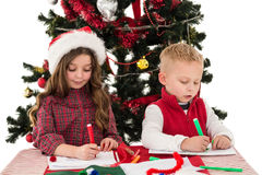 Festive little siblings drawing pictures Stock Photography