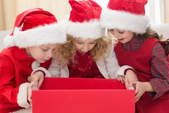 Festive little siblings looking at gift Stock Photos