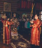 A festive liturgy in an Orthodox church with the participation of the Archbishop, Archdeacon and Subdeacon Stock Photo