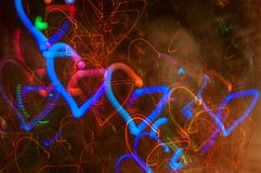 Festive long exposure lights background with hearts. St. Valentine day. Blue hearts stock photos