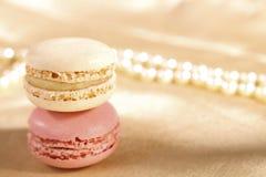 Festive macarons, colorful, shiny glitter backdrop Stock Photo