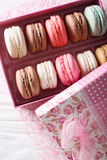 Festive macaroons in a beautiful gift box close-up on a table. V Royalty Free Stock Photo