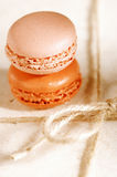 Festive macaroons on gift present box Stock Image