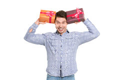Festive man holding christmas gifts on white. Stock Photo