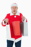 Festive man holding shopping bags Stock Photography