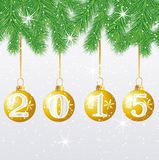 Festive marbles with numbers 2015 hang on the branches of tree Royalty Free Stock Photo