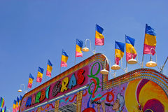 Festive Mardi Gras. A colorful Mardi Gras sign for a ride at the county fair