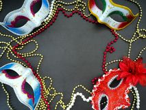 Festive mardi gras venetian carnivale. Festive mardi gras venetian or carnivale mask on a dark background, Empty space for design royalty free stock images