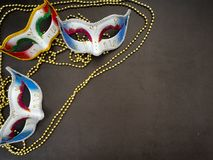 Festive mardi gras venetian carnivale. Festive mardi gras venetian or carnivale mask on a dark background, Empty space for design royalty free stock photos
