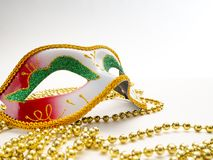 Festive mardi gras venetian carnivale. Festive mardi gras venetian or carnivale mask on a white background, Empty space for design royalty free stock images