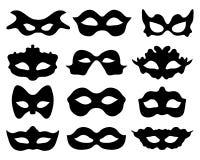 Festive masks. Black silhouette of festive masks in black on a white background Stock Photos