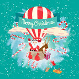 Festive Merry Christmas greeting card with Santa Claus and his d Royalty Free Stock Images