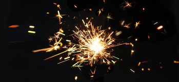 Festive Merry Christmas sparklers on black baclground. Golden Ma Royalty Free Stock Photo