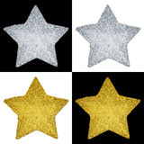 Festive Metallic Stars. Two silver stars & two gold stars on black & white backgrounds Royalty Free Stock Image