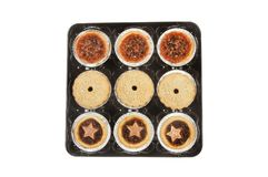 Festive mince pies. In a plastic tray isolated against white stock photography