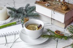 A festive mock up photo with a fir twigs, an opened note book, an old book, a pencil, cones, a candle and decation elements. A festive winter mock up photo with Stock Photos