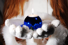 Festive Mood. Girl's hands holding a candle gently royalty free stock photography