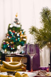 The festive mood. Christmas interior decorations: Christmas tree , lights , sweets and gifts on the table Royalty Free Stock Photos