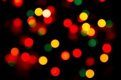 Multicolored Blurry lights on a dark background. royalty free stock photos