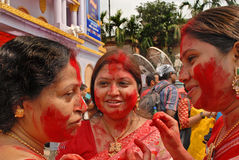 Festive Moods. Beautiful Hindu woman smear and play with vermilion during Sindur Khela traditional ceremony on the final day of Durga Puja festival Royalty Free Stock Image