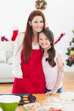 Festive mother and daughter baking together Royalty Free Stock Photos