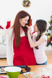 Festive mother and daughter baking together Stock Images