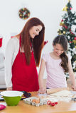 Festive mother and daughter baking together Royalty Free Stock Photo