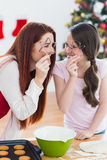Festive mother and daughter baking together Royalty Free Stock Image