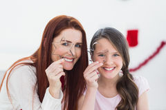 Festive mother and daughter baking together Stock Image