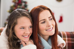 Festive mother and daughter on the couch Royalty Free Stock Photography