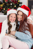 Festive mother and daughter on the couch Stock Images