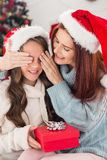Festive mother and daughter on the couch Royalty Free Stock Photo