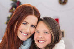Festive mother and daughter on the couch Stock Photography
