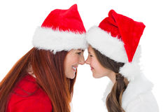 Festive mother and daughter smiling at each other Stock Photo