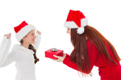 Festive mother giving daughter a gift Stock Photography