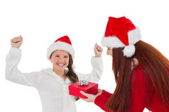 Festive mother giving daughter a gift Stock Images