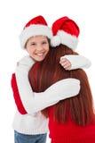 Festive mother giving daughter a hug Royalty Free Stock Photos